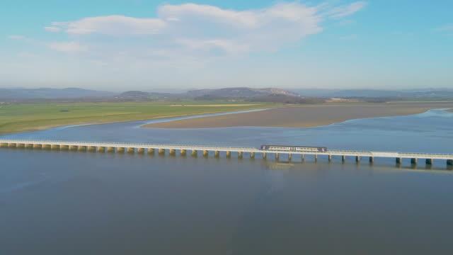 arnside railway train viaduct 4k aerial drone film - viaduct stock videos & royalty-free footage