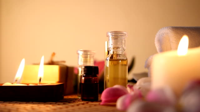 aromatherapy massage oil. - essential oil stock videos and b-roll footage
