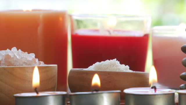 aromatherapy massage setting with candle. - massage oil videos stock videos and b-roll footage
