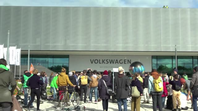 around 100 environmental protesters stage a die-in as shareholders attend volkswagen's annual general meeting in berlin denouncing the impact of the... - annual general meeting stock videos & royalty-free footage