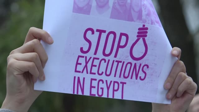 around 200 protesters gather outside the egyptian consulate in istanbul to demonstrate against the recent execution of nine people in egypt - execution stock videos & royalty-free footage