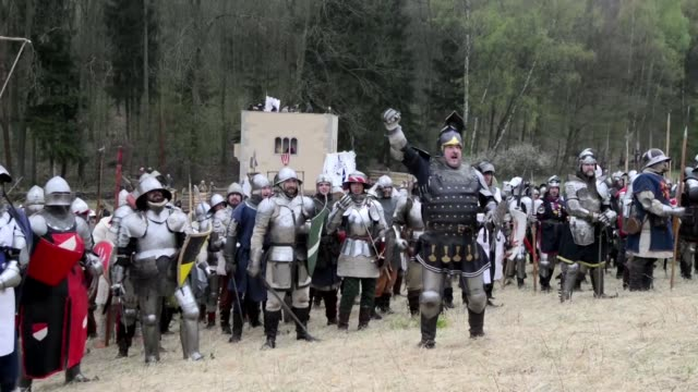Around 2000 history enthusiasts gathered in Libusin in the Czech Republic to dress up as medieval knights and reeanact battles with sword fighting...