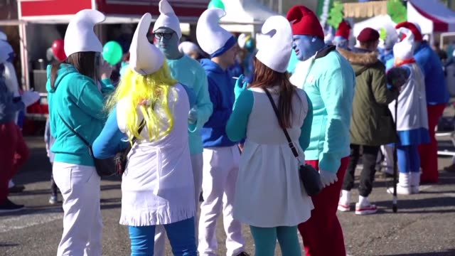 around 2,762 people dressed as smurfs gather in lauchringen germany in an attempt to break the world record for the largest gathering of people... - cartoonist stock videos & royalty-free footage