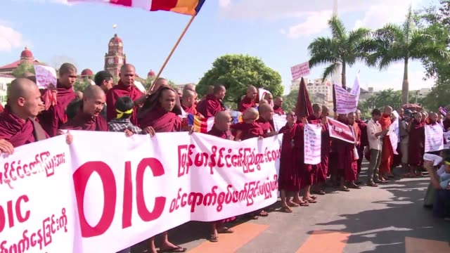 Around 300 Buddhist monks marched through Yangon Tuesday in protest at a looming visit by delegates from the worlds top Islamic body to Myanmar which...
