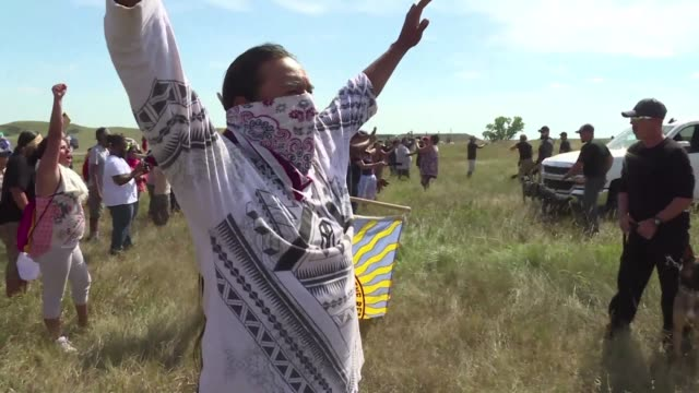 around 300 native americans gathered in cannon ball north dakota on saturday to protest the construction of a pipeline on a field considered to be... - pipeline stock videos and b-roll footage