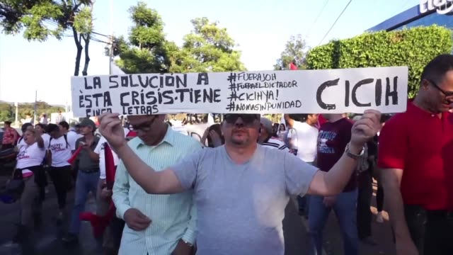 Around 500 people gathered in the Honduran capital in a show of support for Juan Jimenez Mayor who resigned last Thursday as head of the OAS anti...