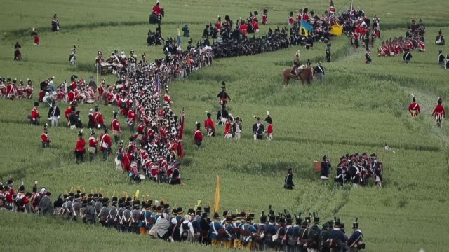 vídeos de stock, filmes e b-roll de around 5000 historical re-enactors will amass this evening to stage the 1st battle re-enactment, the 'french attack', in front of around 200,000... - reconstituição histórica