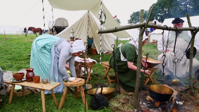 around 5000 historical re-enactors will amass this evening to stage the 1st battle re-enactment, the 'french attack', in front of around 200,000... - historical reenactment stock videos & royalty-free footage