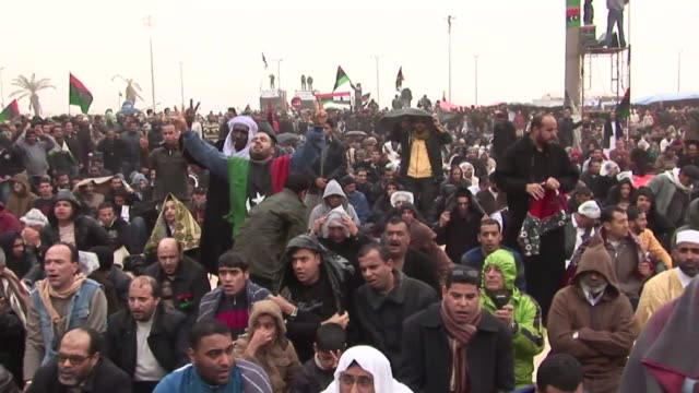 around 5000 people gathered in the central square in benghazi for prayers on friday and vowed they would overthrow their country's embattled leader... - libyan civil war stock videos & royalty-free footage