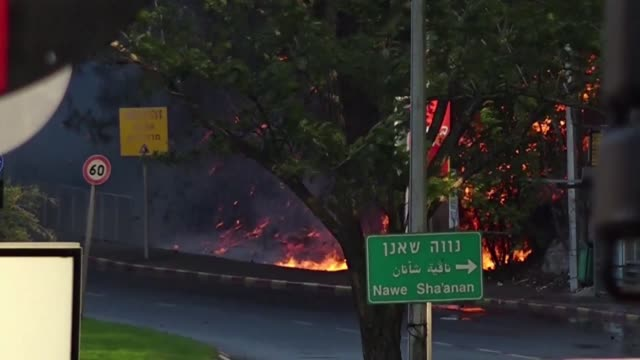 around 50000 people were evacuated from their homes and workplaces in the northern israeli city of haifa on thursday as firefighters battled a series... - haifa stock videos and b-roll footage