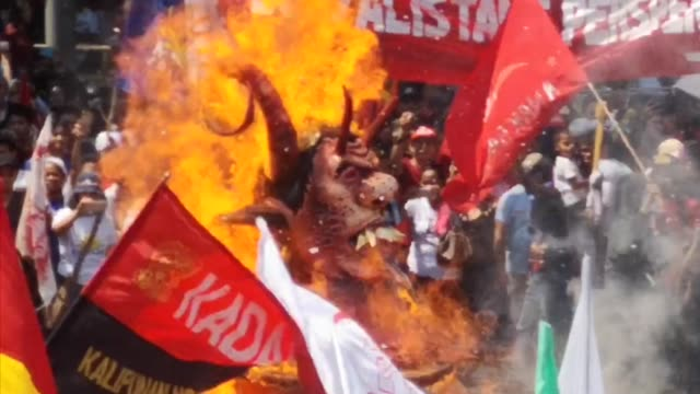 around 5500 labor and militant groups rallied on the streets of manila on may 12019 parading and burning the evil effigy of president rodrigo duterte... - militant groups stock videos and b-roll footage