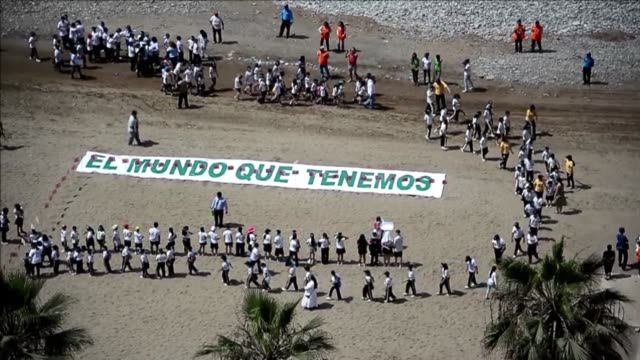 around 700 peruvian children formed a large image of a tree on limas miraflores beach on thursday to raise awareness about climate change - land feature stock videos and b-roll footage