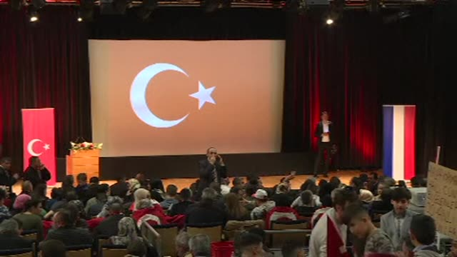 around 800 people from eastern france's turkish community came together in metz on sunday for a meeting with head of turkish diplomacy mevlut... - metz stock videos and b-roll footage
