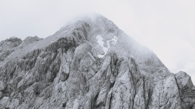 aerial around a rugged mountain ridge - gray color stock videos & royalty-free footage