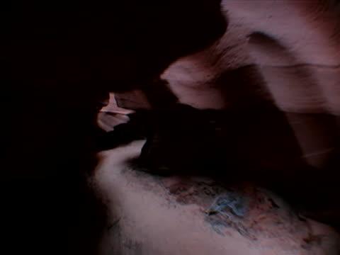 around and under sandstone overhangs - sandstone stock videos & royalty-free footage