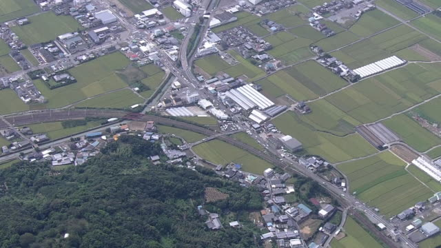 aerial, around gobo, a city in wakayama, japan - railroad car stock videos and b-roll footage