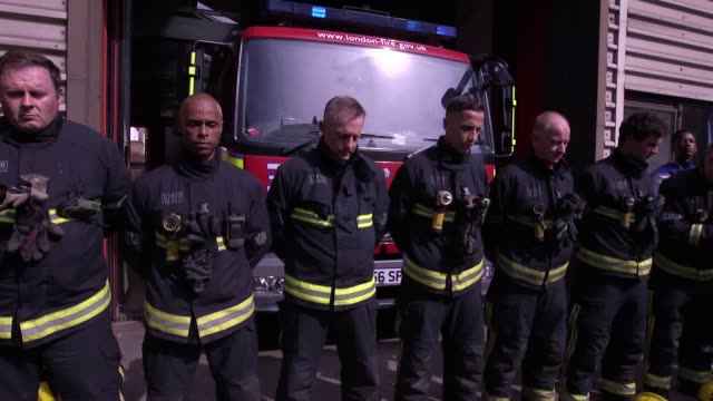 around half a mile away from the charred highrise firefighters lined up removed their helmets and bowed their heads outside north kensington fire... - firefighter stock videos & royalty-free footage