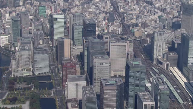 aerial, around marunouchi and otemachi, tokyo, japan - railroad car stock videos and b-roll footage