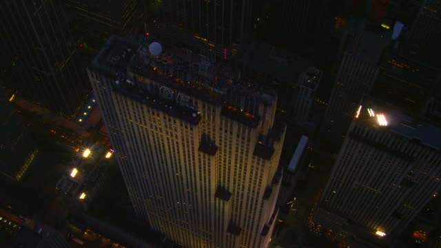 close up aerial around rockefeller center at night - general electric building stock videos and b-roll footage