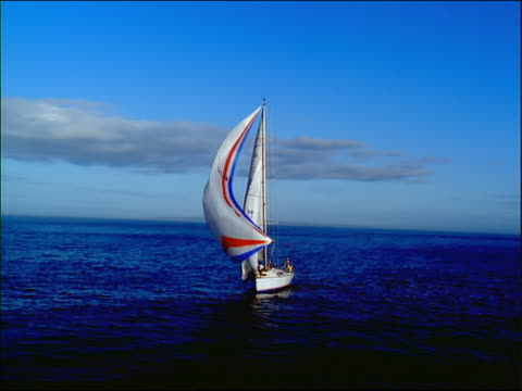aerial around sailboat with full sails on ocean - 船の一部点の映像素材/bロール