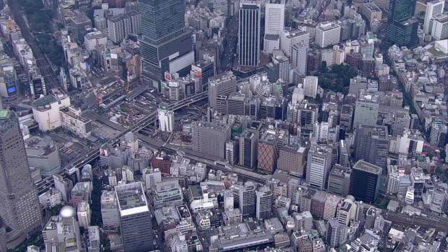 aerial, around shibuya station, tokyo, japan - shibuya station stock videos and b-roll footage