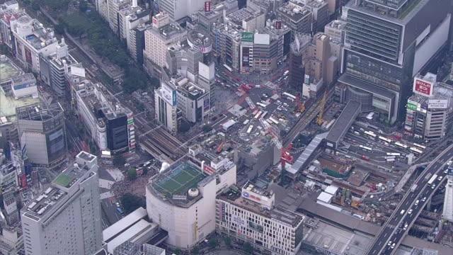 aerial, around shibuya station, tokyo, japan - crane construction machinery stock videos & royalty-free footage