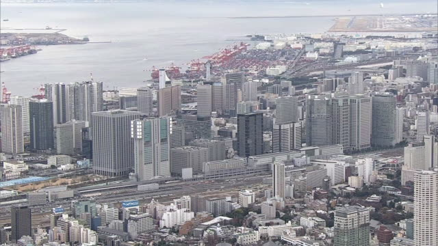 aerial, around shinagawa station, tokyo, japan - tokyo bay stock videos and b-roll footage