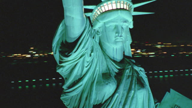 vídeos de stock, filmes e b-roll de aerial around statue of liberty at night / nyc - 2001