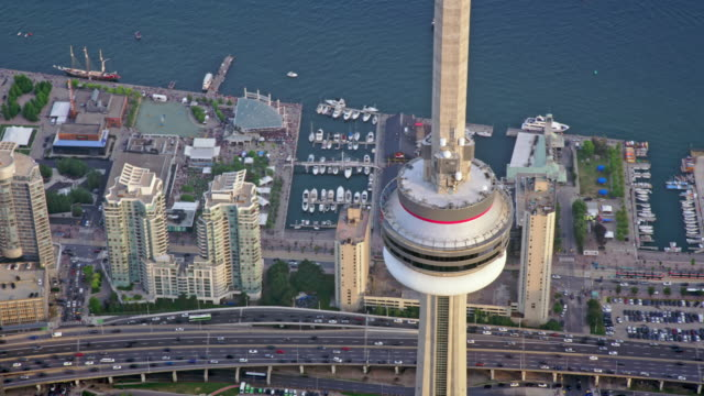 aerial around the 360 the restaurant at the cn tower, in toronto, ontario at sunset - bay of water stock videos & royalty-free footage