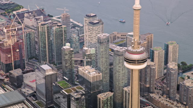 aerial around the top of cn tower in downtown toronto, ontario at sunset - waterfront stock videos & royalty-free footage
