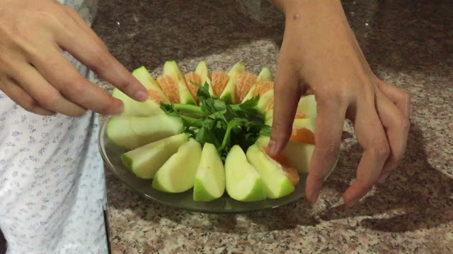arrange green apple, celery and orange fruit on the plate - celery stock videos & royalty-free footage