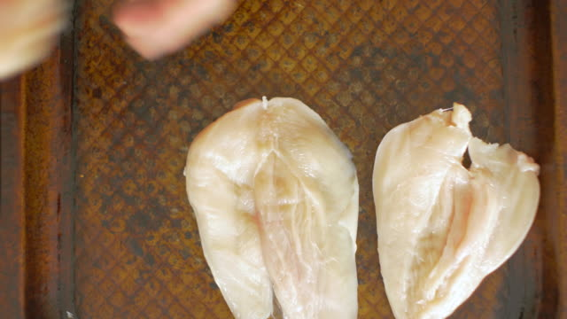 arrange prepared chicken breast on roasting tray - bbq brush stock videos and b-roll footage