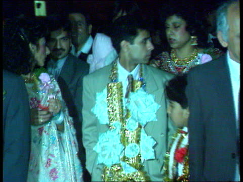 Arranged Muslim marriage bride seeks annulment SCOTLAND Glasgow SEQ Pipers along towards SOF/bride and bridegroom along with Asian guests at arranged...