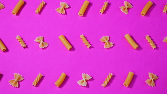 arrangement of uncooked pasta - still life video stock e b–roll