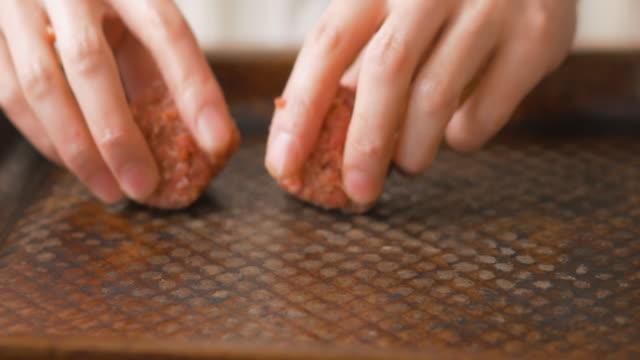 arrangle meatball on baking tray - meatballs stock videos & royalty-free footage