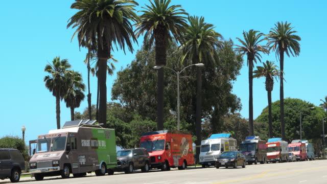 Array of food and juice trucks in Santa Monica, Los Angeles, California, 4K