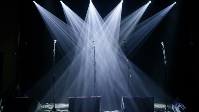 ws array of multicolored lights flashing over an empty stage - stage performance space stock videos & royalty-free footage