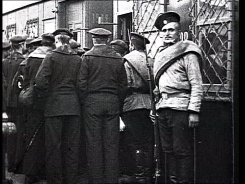 Arrestations and deportations during WWI Pacifists or Bolshevik soldiers in uniforms arrested by Imperial troops are led to a confinement train get...