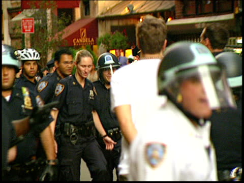 Arrested protestors being led away by police during the 2004 RNC antiwar protests in Union Square in NYC Protestors later won a settlement from the...