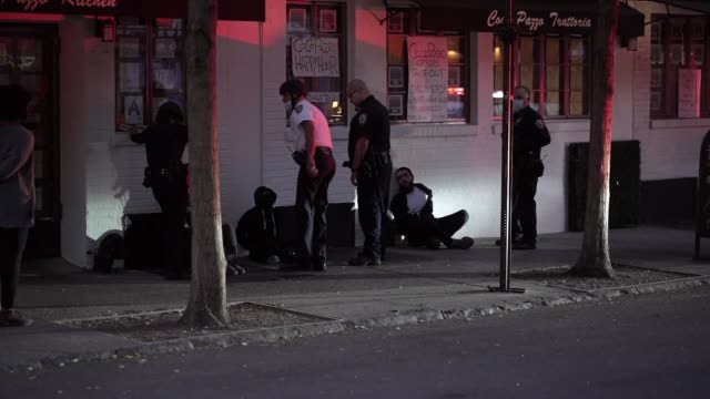 arrests after nyc imposes curfew after 8pm empty streets of soho area that was looted a night before closed off times square to discourage illegal... - arrest stock videos & royalty-free footage