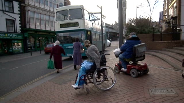 arriva faces court action over disability; location unknown: woman standing next to bus door man stepping onto bus woman in wheelchair next to man in... - pavement stock videos & royalty-free footage