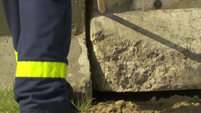 Arrival and mounting of Berlin Wall artifact at new NATO headquarters