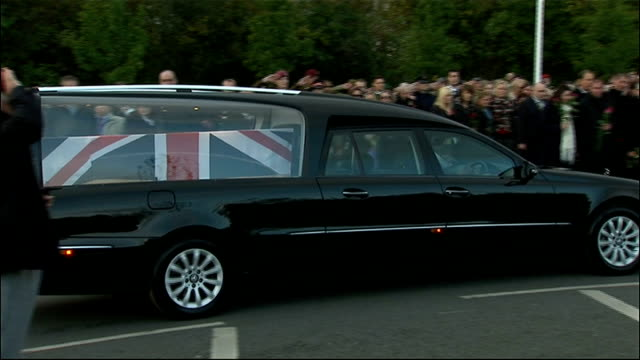 arrival of bodies and families at carterton; carterton: families lining road / members of royal british legion lowering flags as bells toll and... - herunterlassen stock-videos und b-roll-filmmaterial
