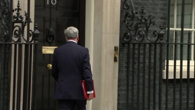 arrivals and departures at downing street / theresa may departure; england: london: downing street: ext arrivals: brandon lewis mp / justine greening... - david m. davis politician stock videos & royalty-free footage