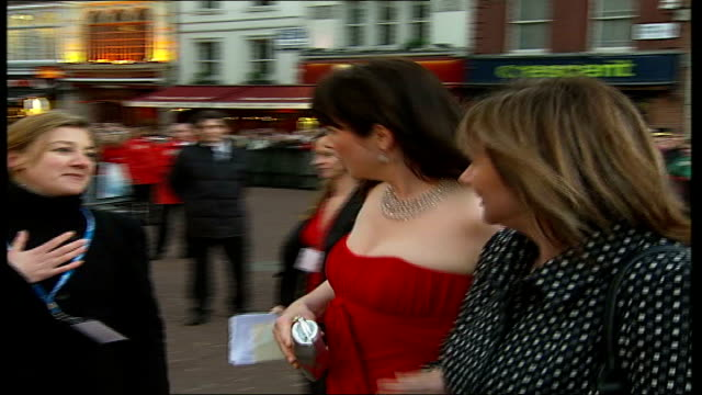 arrivals and interviews at the 'miss potter' premiere emily watson out of car and signs autographs for fans - sleeveless dress stock videos and b-roll footage