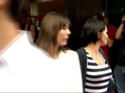 Arrivals at Brasil Brasiliero launch party Sadie Frost wearing black and white striped top heart shaped pendent and blue bag over shoulder saying...