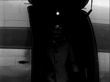 arrivals at london airport; england: london airport : ext frau von werra at bottom of plane steps / frau von werra / hardy kruger down steps followed... - frau stock videos & royalty-free footage
