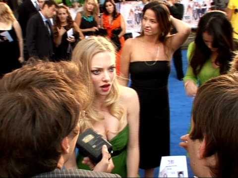 Arrivals at 'Mamma Mia' film premiere Amanda Seyfried wearing green strapless dress interviewed by press