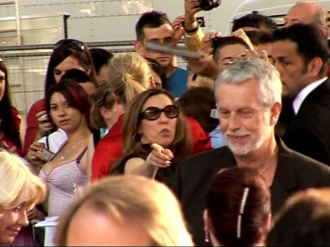 arrivals at 'mamma mia' film premiere back view meryl streep signing auographs for fans and along to speak to press - mamma mia stock videos and b-roll footage