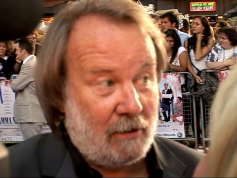 arrivals at 'mamma mia' film premiere benny andersson interviewed by tv crew sot thoughts on film/ joyful experience being involved in this journey... - mamma mia stock videos and b-roll footage